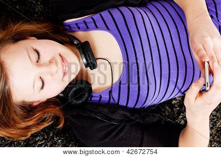 Happy Teenager Girl Listening To Music