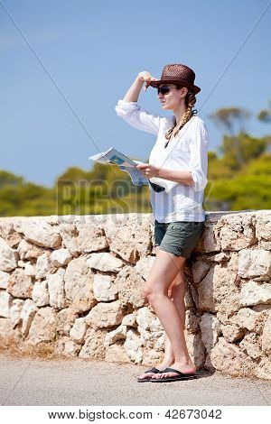 Young Attractive Woman With Land Map In Summer