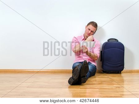 Young Man Calling Helpdesk To Get Information About His Flight
