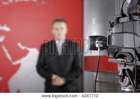 Tv Presenter In Studio In Fron Of The Camera