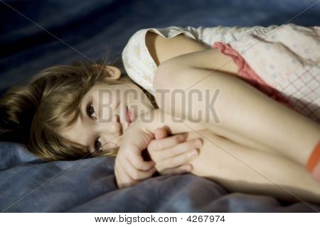 Little Girl Lying Sick In Bed.
