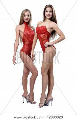 Two Attractive Athletic Girl Posing Over White Background