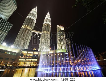 KUALA LUMPUR, MALAYSIA - AUGUST 24: Petronas Twin Towers at night on August 24, 2012 in Kuala Lumpur. Petronas Twin Towers  were the tallest buildings (452 m) in the world from 1998 to 2004.