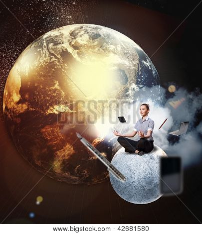 Businesswoman sitting in lotus flower position against space background with office stuff aloft.Elements of this image are furnished by NASA
