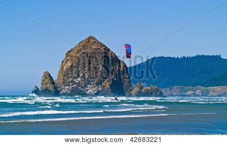 Kite Surfer Out On The Ocean On A Sunny Day At Haystack Rock