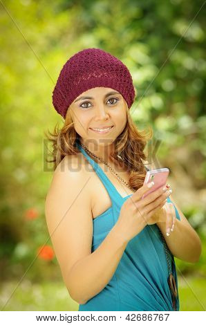 Young Woman with smartphone, green background