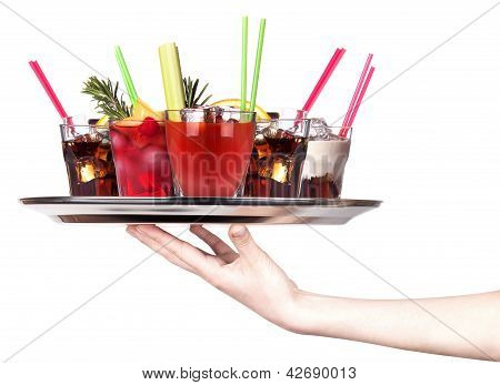 Hand With Alcohol Cocktail On A Silver Tray