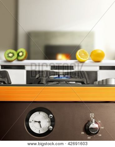 Ultra-modern very clean detail of kitchen stove with abstract look and feel including fireplace in background and fresh fruit on counter