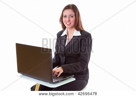 Business woman working on the laptop over white background