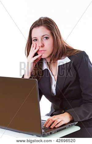 Stressful business woman working on the laptop over white background