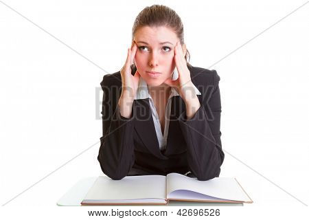 Young brunette hardly studying from the book over white background