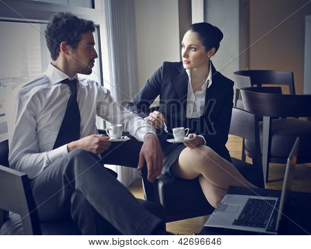 pair of workers talking in coffee break