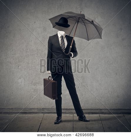 invisible businessman with hat and umbrella