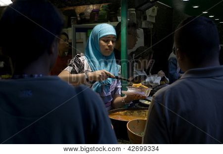 Muslim Young Woman Serving Food