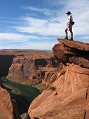 image of grand canyon  - hiker overlooking at the grand canyon - JPG