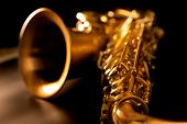 stock photo of wind instrument  - Tenor sax golden saxophone macro with selective focus on black - JPG