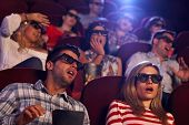 foto of cinema auditorium  - Audience watching 3D horror movie in cinema - JPG
