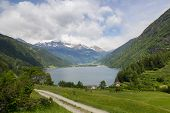 image of engadine  - Lago di Poschiavo is a natural lake in the Poschiavo valley in the canton of Grisons Switzerland - JPG
