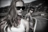image of independent woman  - Couple of modern young people posing on a road over picturesque landscape - JPG