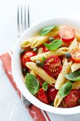 Penne pasta with roasted cherry tomatoes and capers