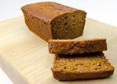 picture of ginger bread  - sliced ginger cake on wooden chopping board - JPG