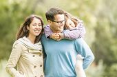 stock photo of three life  - Young happy family of three having fun together outdoor - JPG
