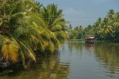stock photo of alleppey  - Houseboat in tropical backwaters of Kerala India - JPG