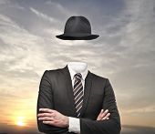 stock photo of riddles  - invisible businessman with hat - JPG