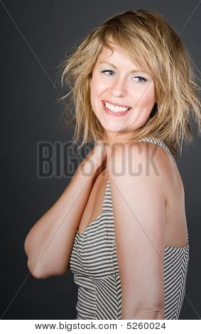 Shot Of A Beautiful Blonde Girl Smiling