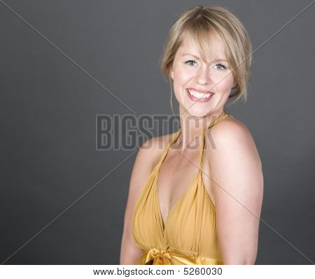 Pretty Blonde Girl Smiling Into The Camera