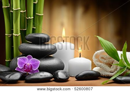 zen basalt stones and orchid on the wood