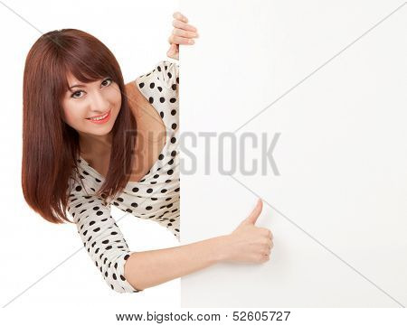 Happy woman with thumbs up sign isolated on white background