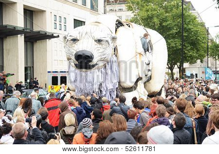 Aurora The Polar Bear Marches With A Crowed Of People To Campaign Against Shells Drilling Operations