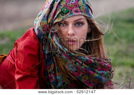young blond woman in autumn fashion clothes,  red leather jacket, cashmere scarf outdoor shot