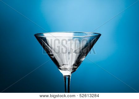 martini glass on blue background