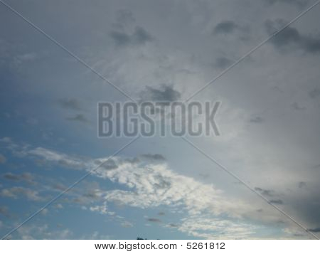 poster of Blue Sky Background With Fluffy White And Gray Clouds