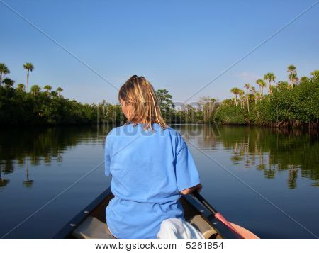 Woman In Canoe