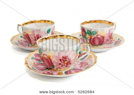 Three Floral-painted Tea Cups With Saucers Isolated