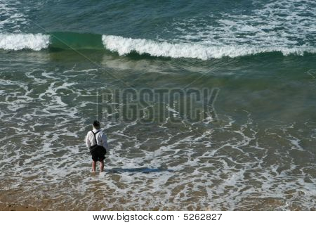 Dressed Man At The Edge Of Sea Wave