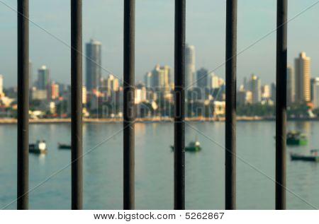Landscape of boats behind bars