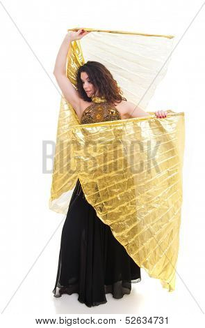 Beautiful young dancer with golden Isis wings
