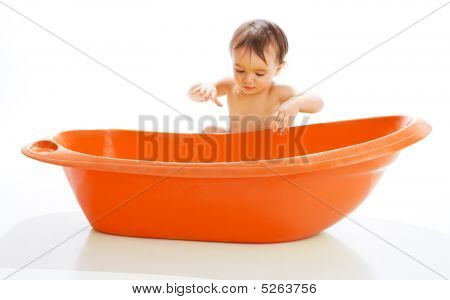 Baby Beside Bathtub