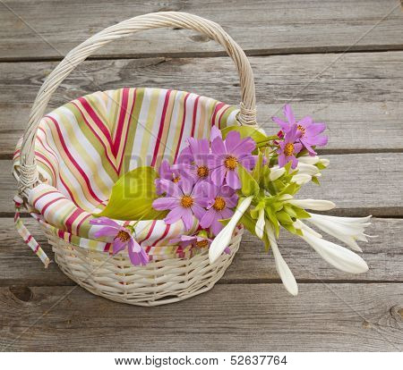 A Bouquet Of  Hosta And Cosmos In A Basket