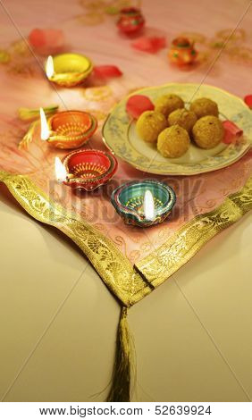 Indian sweets with traditional clay lamps