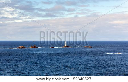 Longships lighthouse and Cornwall coast at Land`s End England on the Penwith peninsula
