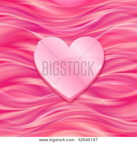 Pink glossy heart on silky background