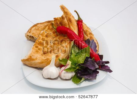 Vegetables On A Plate With A Slice Of Bread