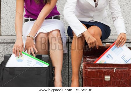 Businesswomen With Budget Reports