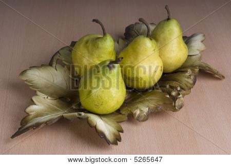 Four Pears On A Table