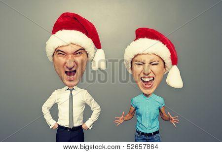 emotional bighead couple in santa hat over dark background